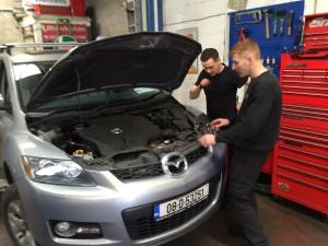 Ronan and James checking car engine