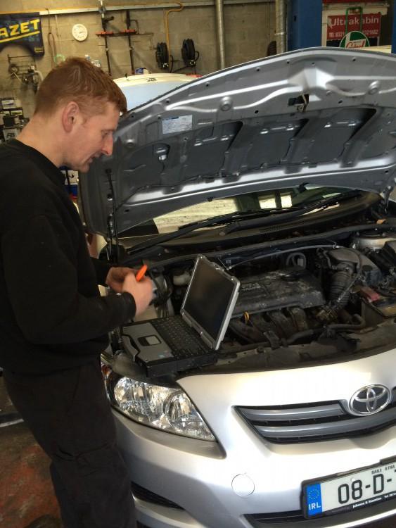 Ronan fixing a car