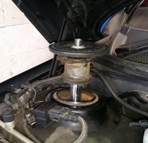 shock absorber broken mount plate